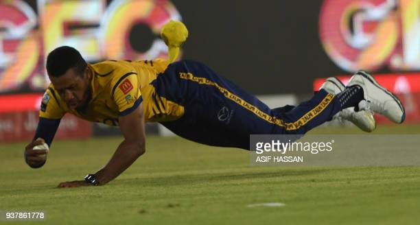 Chris Jordan of Peshawar Zalmi takes a successful catch of Shadab Khan of Islamabad United during the Pakistan Super League final match between...