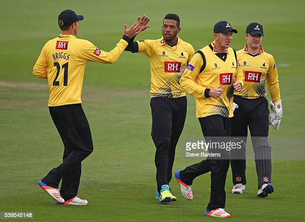 Chris Jordan of Sussex celebrates taking the wicket of Dawid Malan of Middlesex with his team mates during the Royal London One Day Cup match between...