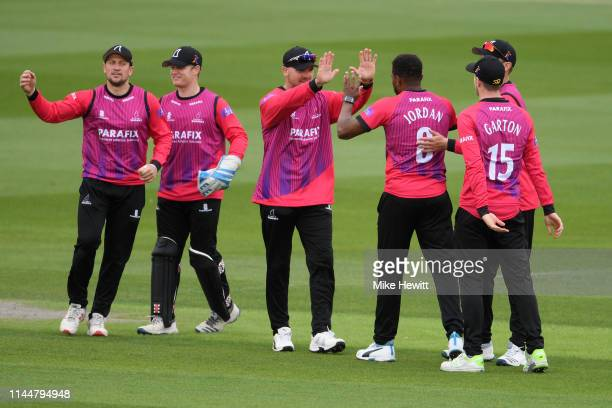 Chris Jordan of Sussex celebrates with team mates after dismissing James Hildreth of Somerset during the Royal London One Day Cup match between...