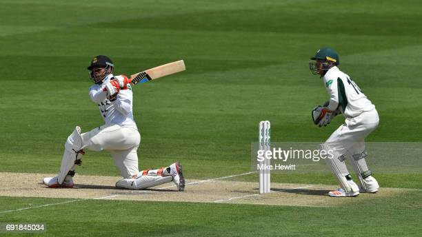 Chris Jordan of Sussex hits out as wicketkeeper Ben Cox of Worcestershire looks on during the Specsavers County Championship Division Two match...