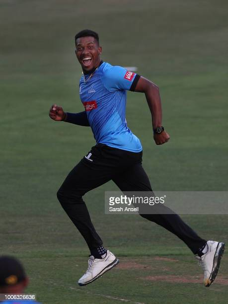 Chris Jordan of Sussex Sharks runs to celebrate with teammates after dismissing Daniel BellDrummond of Kent Spitfires with his first ball during the...