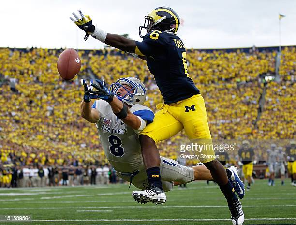 Chris Jordan of the Air Force Falcons can't pull in a third quarter pass under the coverage of Raymon Taylor of the Michigan Wolverines at Michigan...