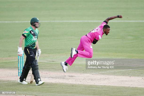 Chris Jordan of the Knights bowls as Bevan Small of the Stags looks on during the Super Smash Grand Final match between the Knights and the Stags at...