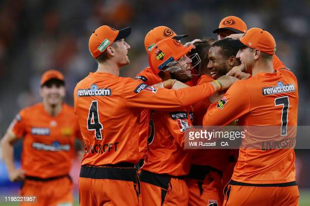 Chris Jordan of the Scorchers celebrates after taking the wicket of Dan Christian of the Renegades during the Big Bash League match between the Perth...