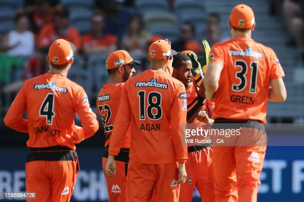 Chris Jordan of the Scorchers celebrates after taking the wicket of Josh Philippe of the Sixers during the Big Bash League match between the Perth...