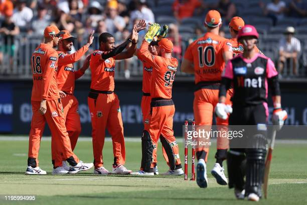 Chris Jordan of the Scorchers celebrates the wicket of Josh Philippe of the Sixers during the Big Bash League match between the Perth Scorchers and...