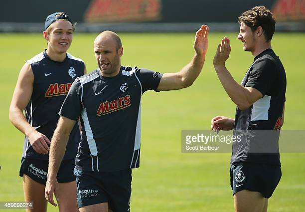 Chris Judd and Andrejs Everitt of the Blues celebrate after a training drill during a Carlton Blues AFL preseason training session at Visy Park on...