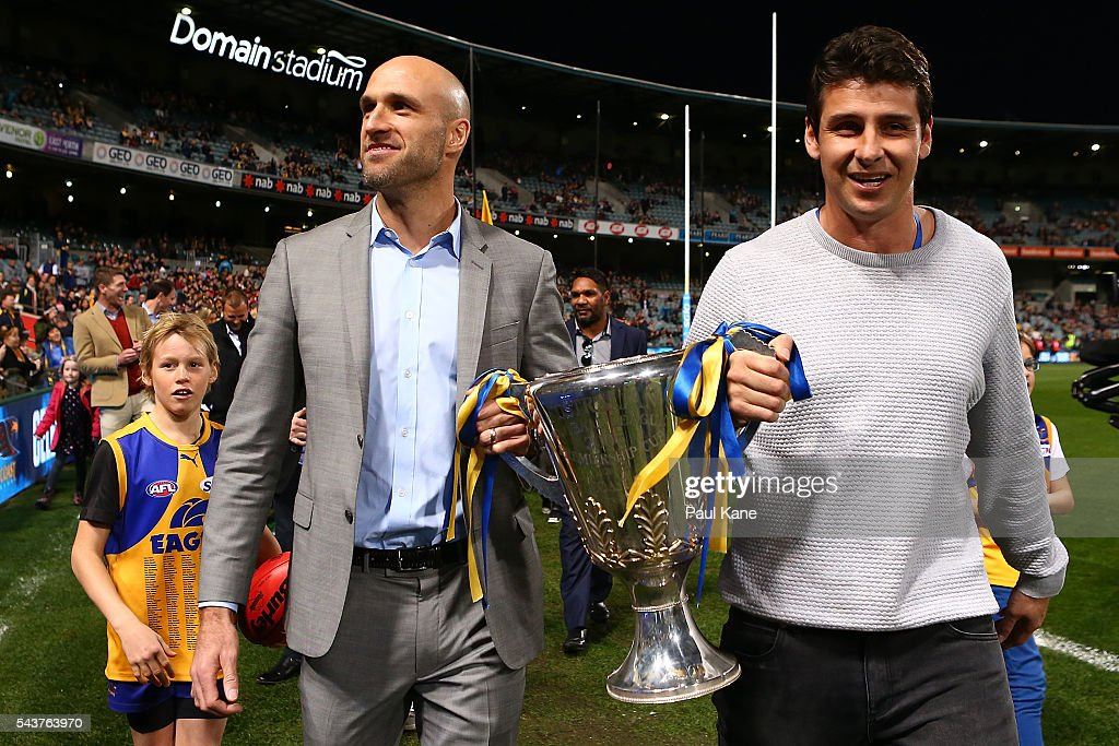 Chris Judd and Andrew Embley walk a lap of honour with team mates celebrating the West Coast Eagles 2006 Premiership anniversary during the round 15 AFL match between the West Coast Eagles and the Essendon Bombers at Domain Stadium on June 30, 2016 in Perth, Australia.