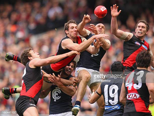 Chris Judd of the Blues competes for the ball during the round 21 AFL match between the Essendon Bombers and the Carlton Blues at the Melbourne...
