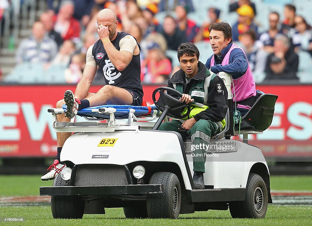 Chris Judd of the Blues is stretchered from the ground after injuring his knee during the round 10 AFL match between the Carlton Blues and the Adelaide Crows at Melbourne Cricket Ground on June 6, 2015 in Melbourne, Australia.