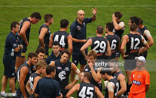 Chris Judd of the Blues speaks to the Navy team midfielders during the Carlton Blues AFL intra-club match at Visy Park on February 17, 2012 in...