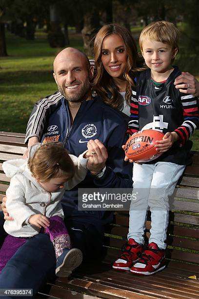 Chris Judd Rebecca Judd and their children Oscar Judd and Billie Judd pose following a Carlton Blues AFL press conference announcing Chris's...