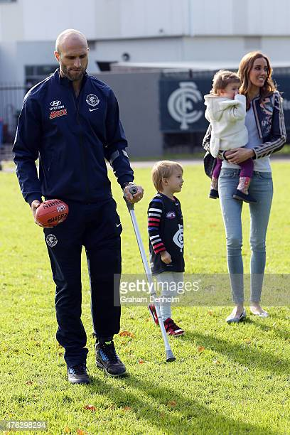 Chris Judd Rebecca Judd and their children Oscar Judd and Billie Judd leave the building following a Carlton Blues AFL press conference announcing...