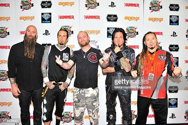 Chris Kael Jeremy Spencer Ivan Moody Jason Hook and Zoltan Bathory of American heavy metal group Five Finger Death Punch photographed on the red...