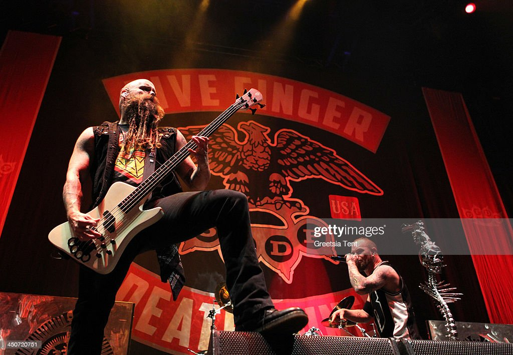 Chris Kael of Five Finger Death Punch performs supporting Avenged Sevenfold at the Ziggo Dome on November 19, 2013 in Amsterdam, Netherlands.