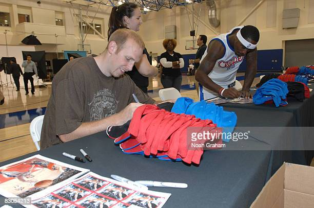 Chris Kaman and Ricky Davis the Los Angeles Clippers sign memorabilia during NBA Media Day on September 29 2008 at the Clippers Training Facility in...