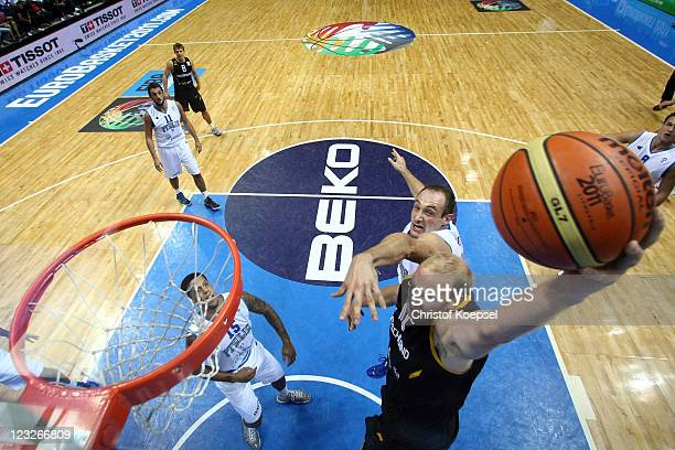 Chris Kaman of Germany shoots over Marco Cusin of Italy during the EuroBasket 2011 first round group B match between Italy and Germany at Siauliai...