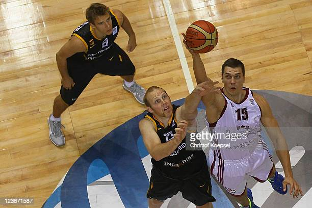 Chris Kaman of Germanyand Andrejs Selakovs of Latvia fight for the ball during the EuroBasket 2011 first round group B match between Latvia and...