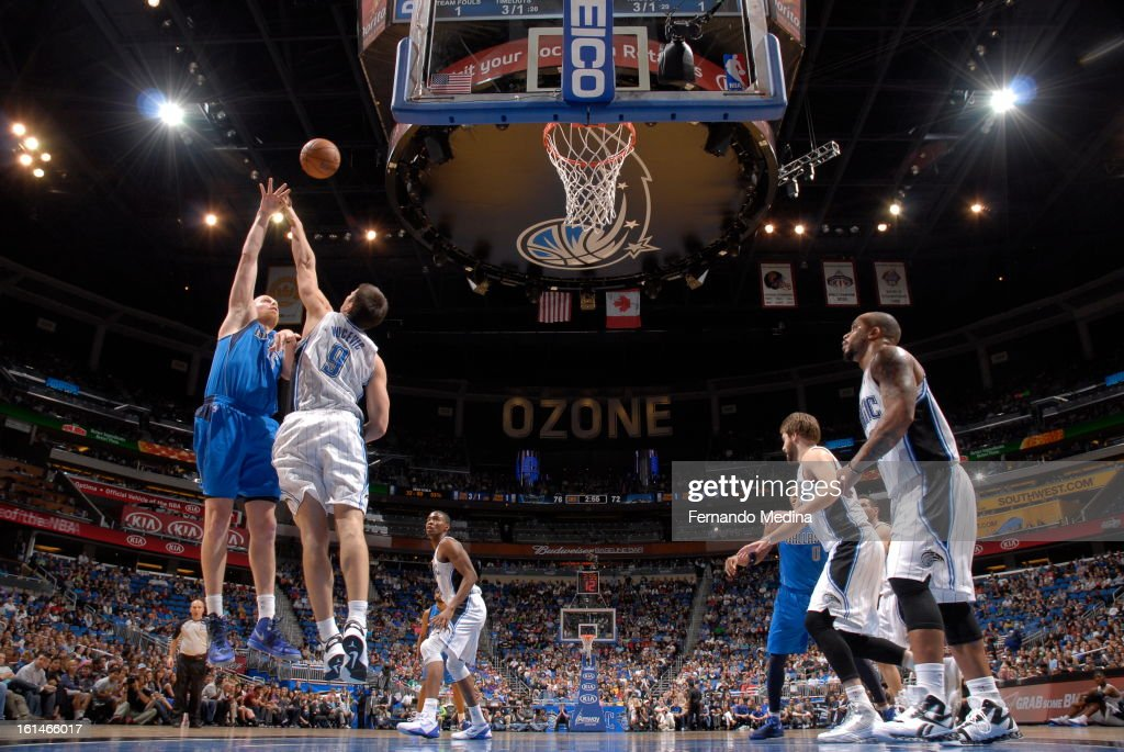 Chris Kaman #35 of the Dallas Mavericks goes up for the hook-shot against Nikola Vucevic #9 of the Orlando Magic during the game on January 20, 2013 at Amway Center in Orlando, Florida.