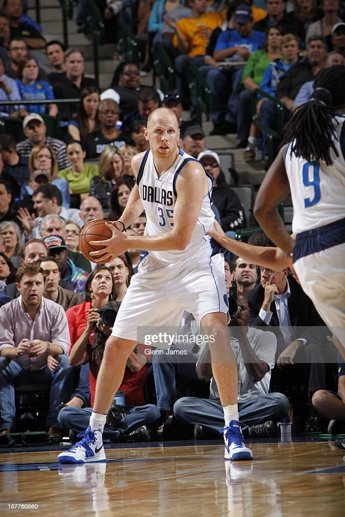 Chris Kaman #35 of the Dallas Mavericks looks to pass the ball against the Toronto Raptors on November 7, 2012 at the American Airlines Center in Dallas, Texas.