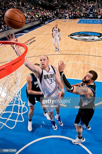 Chris Kaman of the Dallas Mavericks shoots a layup against Nikola Pekovic of the Minnesota Timberwolves on January 14 2013 at the American Airlines...
