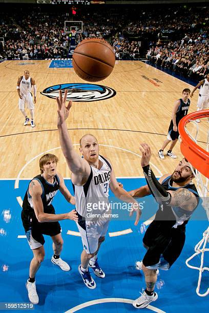 Chris Kaman of the Dallas Mavericks shoots in the lane against Nikola Pekovic and Andrei Kirilenko of the Minnesota Timberwolves on January 14 2013...