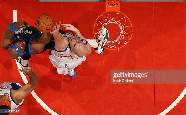 Chris Kaman of the Los Angeles Clippers battles for a rebound against Brendan Haywood of the Dallas Mavericks at Staples Center on April 12 2010 in...