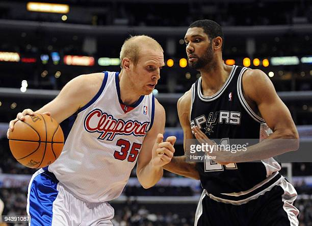 Chris Kaman of the Los Angeles Clippers dribbles to the basket in front of Tim Duncan of the San Antonio Spurs at Staples Center on December 13 2009...