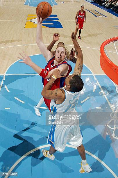 Chris Kaman of the Los Angeles Clippers shoots over Marcus Camby of the Denver Nuggets in game four of the Western Conference Quarterfinals during...
