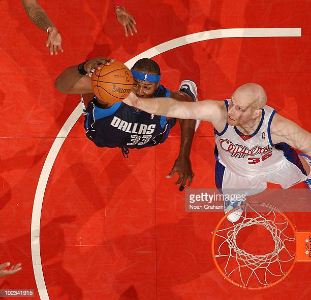 Chris Kaman of the Los Angeles Clippers tries to gain control of the ball against Brendan Haywood of the Dallas Mavericks at Staples Center on April...