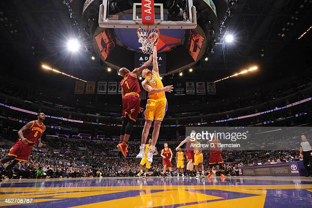Chris Kaman of the Los Angeles Lakers dunks against Jarrett Jack of the Cleveland Cavaliers at Staples Center on January 14 2014 in Los Angeles...