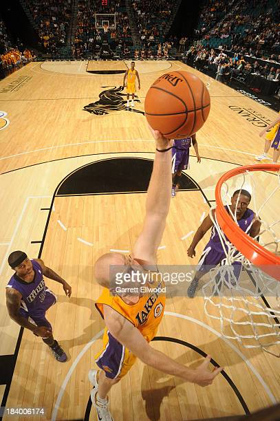 Chris Kaman of the Los Angeles Lakers goes up for the dunk against the Sacramento Kings at the MGM Grand Garden Arena on October 10 2013 in Las Vegas...