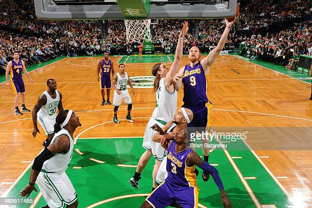 Chris Kaman of the Los Angeles Lakers goes up for the layup against the Boston Celtics on January 17 2014 at the TD Garden in Boston Massachusetts...