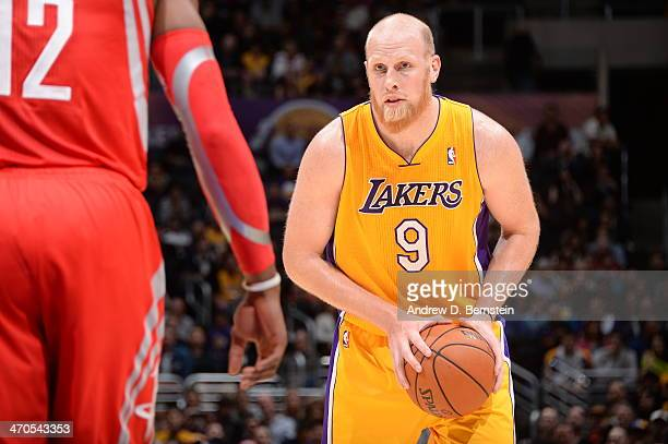 Chris Kaman of the Los Angeles Lakers handles the basketball during a game against the Houston Rockets at STAPLES Center on February 19 2014 in Los...