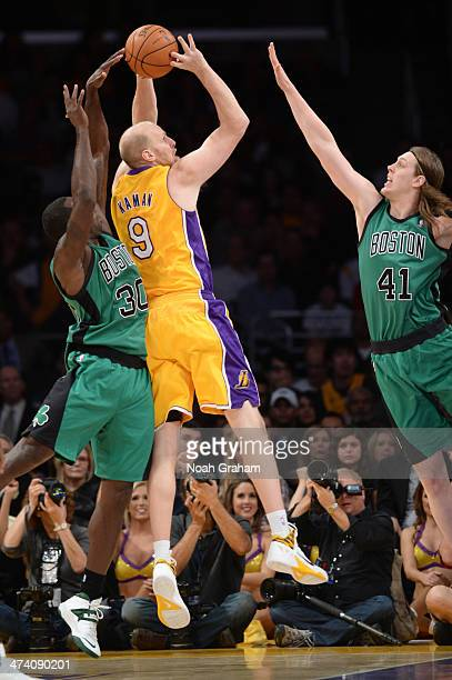 Chris Kaman of the Los Angeles Lakers shoots against Kelly Olynyk of the Boston Celtics at STAPLES Center on February 21 2014 in Los Angeles...