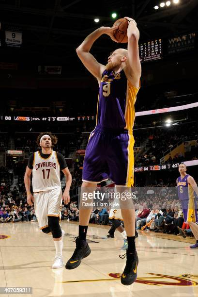 Chris Kaman of the Los Angeles Lakers shoots against the Cleveland Cavaliers at The Quicken Loans Arena on February 5 2014 in Cleveland Ohio NOTE TO...