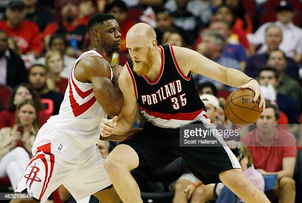 Chris Kaman of the Portland Trail Blazers drives with the ball against Terrence Jones of the Houston Rockets during their game at the Toyota Center...