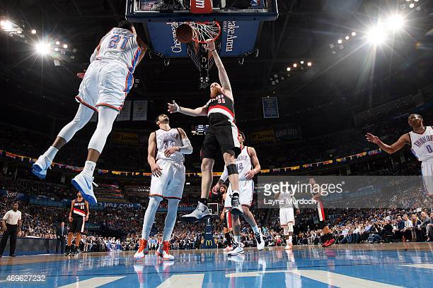 Chris Kaman of the Portland Trail Blazers dunks against the Oklahoma City Thunder on April 13 2015 at Chesapeake Energy Arena in Oklahoma City...