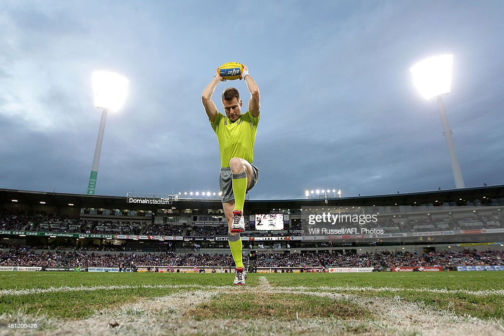 Chris Kamolins practices a centre bounce before the round 16 AFL match between the Fremantle Dockers and the Carlton Blues at Domain Stadium on July 18, 2015 in Perth, Australia.