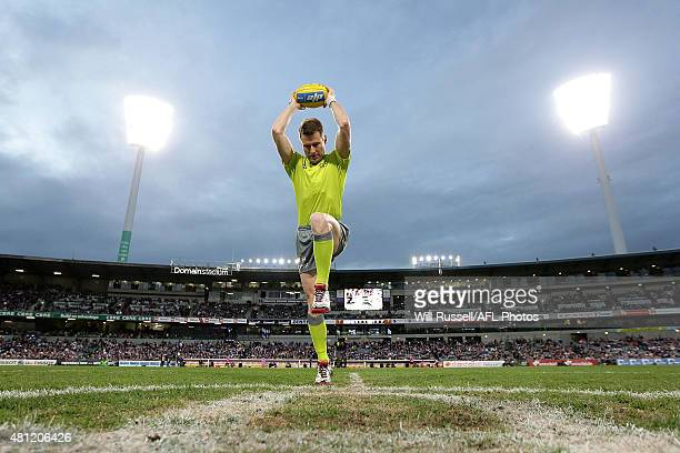 Chris Kamolins practices a centre bounce before the round 16 AFL match between the Fremantle Dockers and the Carlton Blues at Domain Stadium on July...