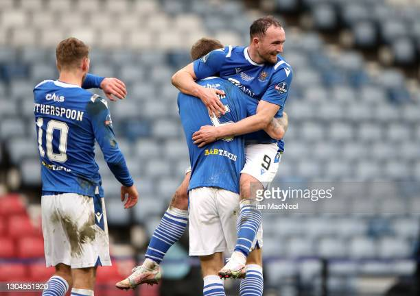 Chris Kane of St Johnstone celebrates victory with team mate Jason Kerr following the Betfred Cup Final match between Livingston and St Johnstone at...
