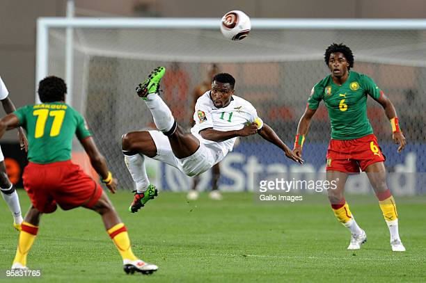 Chris Katongo of Zambia in action as Jean Makoun and Alexandre Song of Cameroon look on during the African Nations Cup group D match between Cameroon...