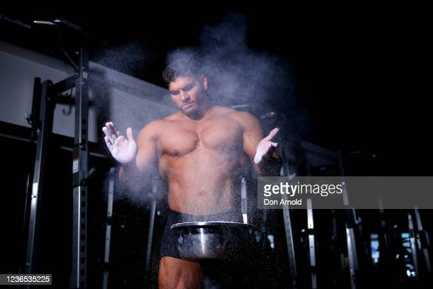 Chris Kavvalos applies chalk to his hands during a workout at City Gym on May 31, 2020 in Sydney, Australia. IFBB body builder Chris Kavvalos has...