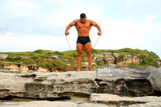 Chris Kavvalos does some resistance exercises with a rope during an early morning photo shoot at Little Bay on May 31, 2020 in Sydney, Australia....