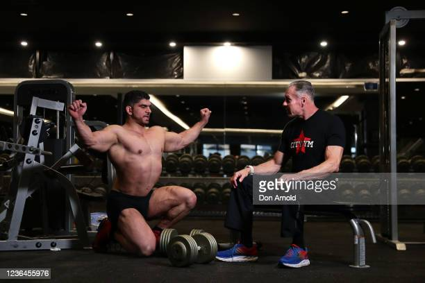 Chris Kavvalos is seen in discussion with Paul Haslam during a workout at City Gym on May 24, 2020 in Sydney, Australia. IFBB body builder Chris...