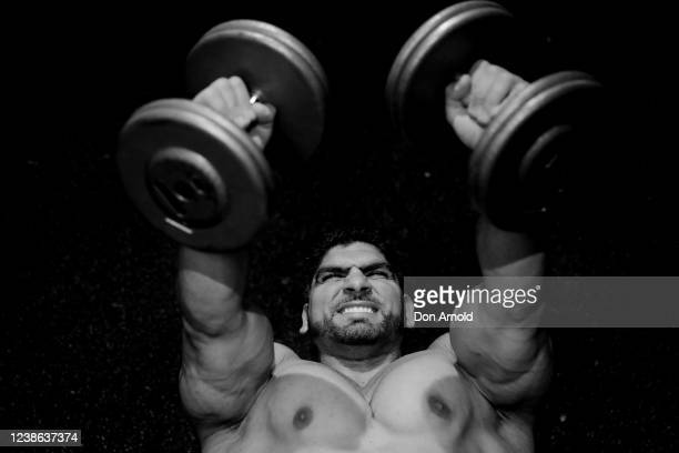 Chris Kavvalos performs a dumbbell press on May 24, 2020 in Sydney, Australia. IFFBB body builder Chris Kavvalos has continued training in Sydney...
