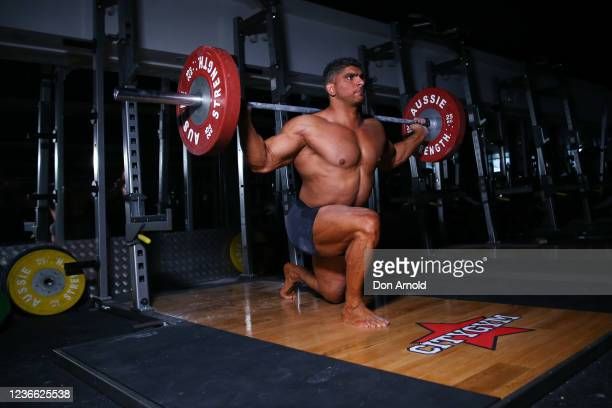 Chris Kavvalos performs a squat exercise during a workout at City Gym on May 31, 2020 in Sydney, Australia. IFBB body builder Chris Kavvalos has...