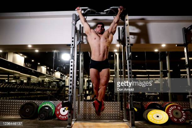 Chris Kavvalos performs chin ups during a workout at City Gym on May 24 2020 in Sydney Australia IFBB body builder Chris Kavvalos has continued...