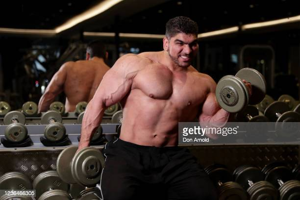 Chris Kavvalos performs some bicep curls during a workout at City Gym on May 24, 2020 in Sydney, Australia. IFBB body builder Chris Kavvalos has...