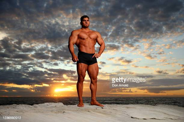 Chris Kavvalos poses during an early morning photo shoot at Little Bay on May 31, 2020 in Sydney, Australia. IFBB body builder Chris Kavvalos has...
